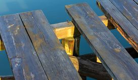 Old wooden pier on the lake stock photography