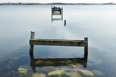 Old wooden pier on the lake Stock Photo