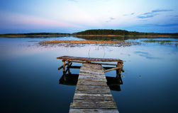Old Wooden pier on the lake. Stock Photos
