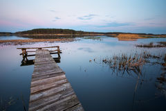 Old Wooden pier on the lake. Long exposure Stock Photo