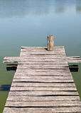 Old wooden pier on the lake Royalty Free Stock Photos