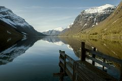 Old wooden pier at the lake, Norway. Old wooden pier at the lake in Norway Stock Image