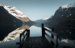 Old wooden pier at the lake in Norway. Old wooden pier at the lake, Norway Royalty Free Stock Image