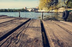 Old wooden pier on the lake. reto creative style. Copy space Royalty Free Stock Photo