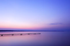 Old wooden pier on a lake at sunrise Stock Photography