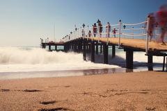 Old wooden pier over the sea shore Royalty Free Stock Image