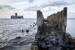 Old wooden pier and ruins of torpedo factory Stock Images