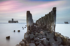 Old wooden pier and ruins of torpedo factory Royalty Free Stock Image