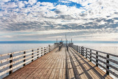 Old wooden pier in the sea Stock Images