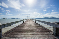 old wooden pier and the sea with cloud moving Royalty Free Stock Photos