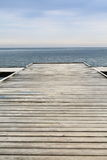 Old wooden pier at the sea. Old wooden empty pier jetty at the sea - Sopot Poland Stock Photography