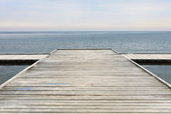 Old wooden pier at the sea Royalty Free Stock Photos