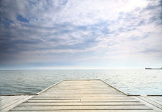 Old wooden pier at the sea. Old wooden empty pier jetty at the sea - Sopot Poland royalty free stock image