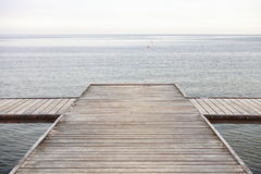 Old wooden pier at the sea. Old wooden empty pier jetty at the sea - Sopot Poland royalty free stock photography
