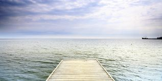 Old wooden pier at the sea Royalty Free Stock Photo