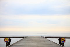 Old wooden pier at the sea Stock Photo