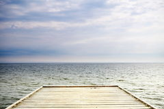 Old wooden pier at the sea Stock Image