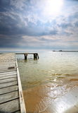 Old wooden pier at the sea sunrise or sunset. Old wooden empty pier jetty at the sea sunrise or sunset - Sopot Poland royalty free stock image