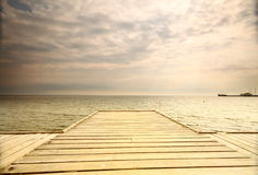 Old wooden pier at the sea sunrise or sunset. Old wooden empty pier jetty at the sea sunrise or sunset - Sopot Poland stock image