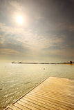 Old wooden pier at the sea sunrise or sunset. Old wooden empty pier jetty at the sea sunrise or sunset - Sopot Poland royalty free stock photos