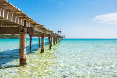 Old wooden pier in the sea Stock Photography