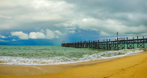Old wooden pier stretching out to sea Royalty Free Stock Image