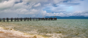 Old wooden pier stretching out to sea Stock Image