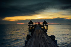 Old wooden pier at twilight Stock Image