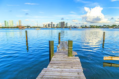 Old wooden pier with view to modern skyline of Miami Royalty Free Stock Image
