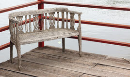 Old wooden pier with wooden chairs as well. Old wooden pier with wooden chairs as well Royalty Free Stock Images