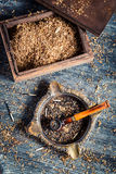 Old wooden pipe with tobacco in an ashtray Royalty Free Stock Photos