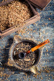 Old wooden pipe with tobacco Stock Photos