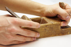Old wooden plane in a hand job Stock Photo