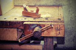 Old wooden plane on the table of the workshop of carpenter with Stock Images