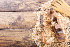 Old wooden planer with sawdust. In a carpentry workshop Stock Photography