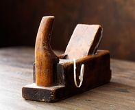 Old wooden planer . Old wooden planer on the table in the workshop Stock Photos