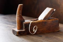 Old wooden planer . Old wooden planer on the table in the workshop Stock Image
