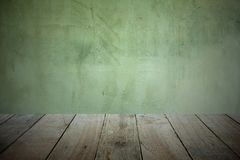 Old wooden plank floor in front for product display and the background is the old cement wall. With dark theme stock photo