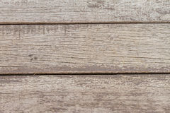 Old wood spread horizontally in the background. Stock Photo