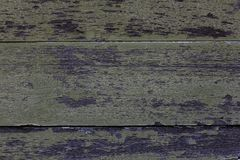 Old wooden planks, green peel off. stock photo