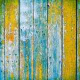 Old wooden planks painted with paint cracked by a rustic backgro Stock Photography