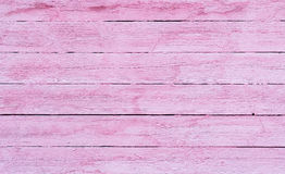 Old wooden planks painted with pink paint cracked by a rustic ba. Pink wood texture background cracked Stock Image