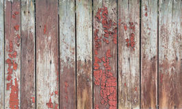 Old wooden planks with remnants of red paint Stock Photography