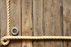 Old wooden planks and rope with compass Stock Photography