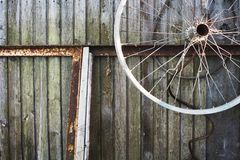 Old wooden planks, rusty wheel and rusty metal. stock image