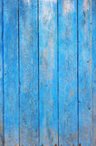 Old Wooden Planks Wall. A background made of wooden boars painted with blue paint royalty free stock photos