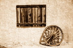 Old wooden plate and wheel Stock Photo