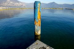 Lake Iseo in Lombardy. An old wooden pole in the lake at Lake Iseo in Lombardy, Italy royalty free stock images