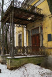Old wooden porch. With pillars and iron railings Stock Photo