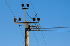 Old wooden power transmission pole with wires Royalty Free Stock Photo